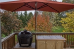 The umbrella is rectangular and 6.5' x 10' so it covers the grill and the cart nicely. I'll be grilling rain, snow or shine